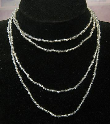 Wonderful long single strand necklace of mini clear milky white beads