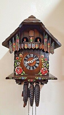 Vintage German 1 day hand curved and painted musical animated cuckoo clock
