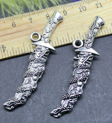The delicate and lovely engraving of a dragon symbol with a knife pendant