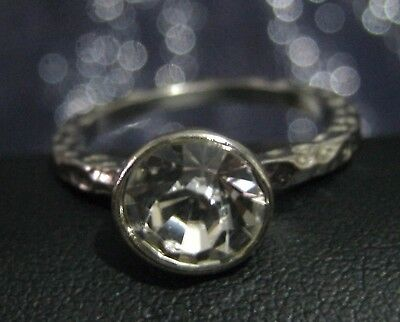 Lovely silver tone metal ring with dimpled surface and nice white stone size R½