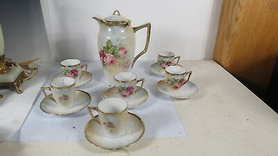 Antique porcelain Chocolate  Pot  and 6  cups and saucers Roses
