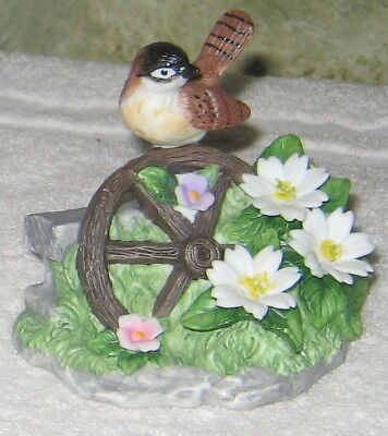 Old Wagon Wheel With Little Sparrow  Sitting On It In Fine Porcelain