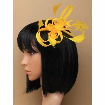 Neon Yellow Coiled Net and Feather Fascinator on a clear comb Headpieces Flower