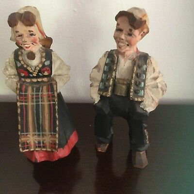 Pair of vintage Swedish folk art carved wooden figurines in traditional dress