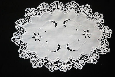 Vintage white linen oval shaped doily with crochet edge and white cutwork.
