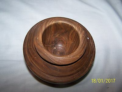 An unlidded dark wood wooden pot / jar (N)