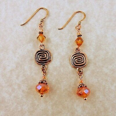 Copper Celtic spiral earrings with Crystal Copper Swarovski beads