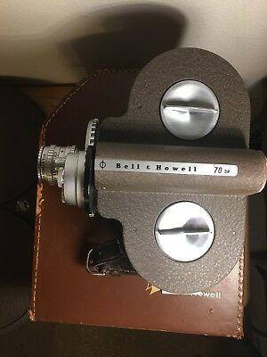 Bell & Howell 70 DR 16mm Movie Camera, w/case, lens, canister & manual