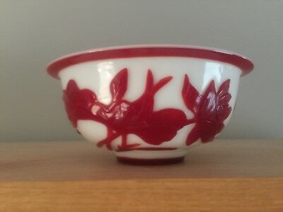 A Stunning larger sized Peking glass white with red overlay bowl