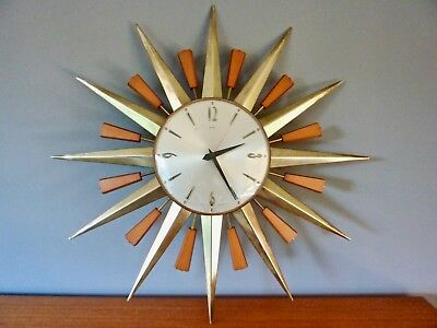 Metamec Vintage 1970'S Teak & Gold Starburst Wall Clock In Full Working Order.