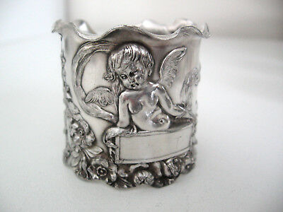 Extraordinary v.ornate nouveau sterling silver napkin ring with a cupid or angel