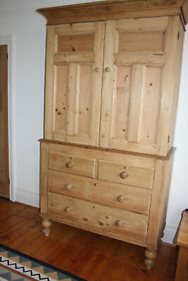 antique pine linen press/ 2 door cupboard and 4 draws