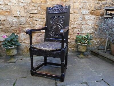 Oak jointed 17th century style wainscot chair with 18th century damask cushion
