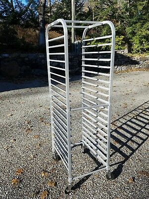 aluminum bakers rack, 20 inches wide by 26 inches deep, and 70 inches tall.