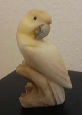 Intricate parrot figurine carving