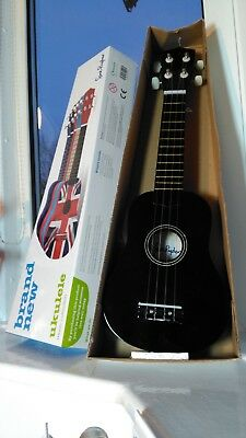 Ukulele in box never been used. Black. Sue Ryder
