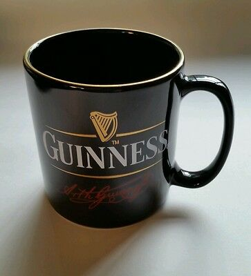 "Guinness Beer coffee mug 3 1/2""h x 3""w not including handle"