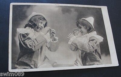 Vintage 1910 postcard 'Tit for Tat' with 2 children in hats.