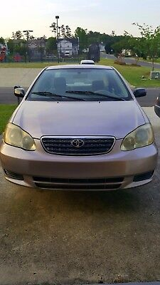 2003 Toyota Corolla  Toyota Corolla CE - Tan/gold in excellent condition