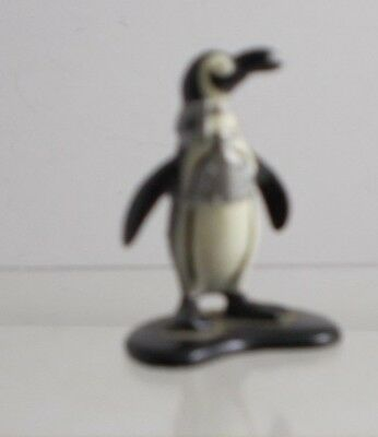 ^^   Penguin Ertl Metal Tiny Figire With Rocket On Back