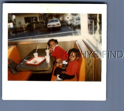 Found Color Kodak M+5999 Black Boy And Girl Sitting At Table In Restaurant