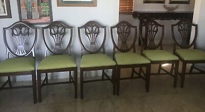 Hepplewhite Six Shield Back Dining Chairs in dark wood with upholstered seats