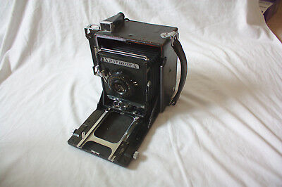 Graflex anniversary with graflarger back, polaroid back and speed graphic front