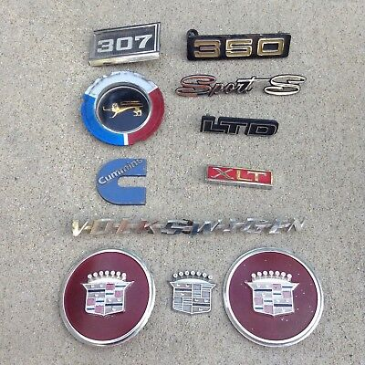 Lot of 11 Vtg Car Truck Metal/ Plastic Emblems Nameplates Logos Tags VW Cadillac