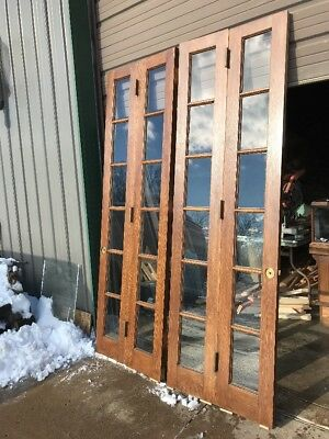 An 441 Match Pair Antique Bi-fold Oak Doors 5' X 93.5