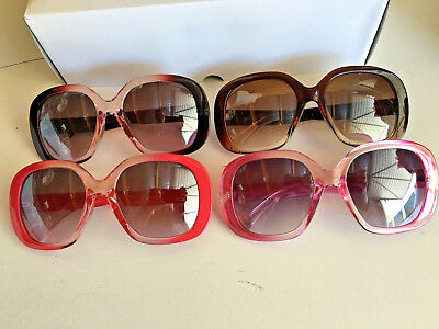 Lot of 4 designer look sunglasses.Wholesale.Seller.Good quality.New .3 colors.