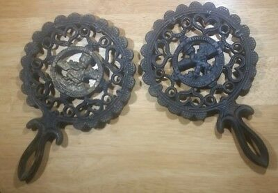 Two Vintage cast iron trivets Amish lot