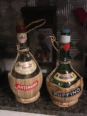 Two vintage wicker wrapped wine bottles with original labels.  Green embossed Gl