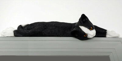 Black and White Tuxedo Lazy cat figurine door topper with yellow eyes
