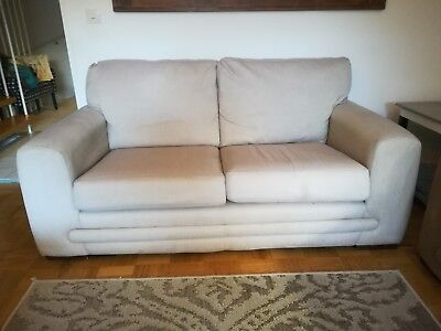 Used 2 sitter beige sofa in good condition for sale (170 cms * 94 cms)
