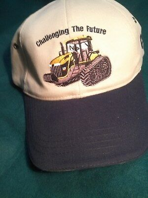 New Genuine CAT Caterpillar Ball Cap Hat -tan and blue mt7oo series launch 2001