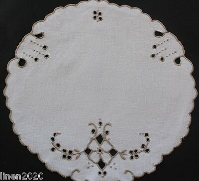 Vintage off white and ecru linen embroidered doily/cloth.
