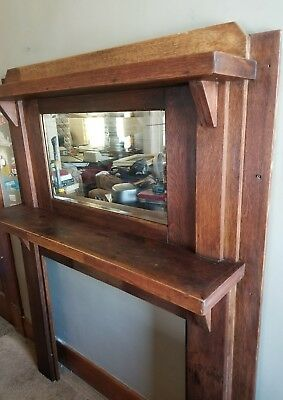 Antique wood fireplace mantel with mirror