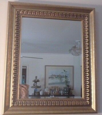 Bevelled edge mirror in decorative gold frame