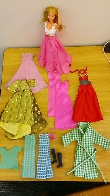 Vintage 1966 Barbie doll with lot of clothes and shoes