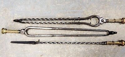 A set of mid 19th century gilt bronze & steel antique fireside tools irons