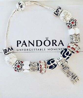 """Authentic Pandora Sterling Silver Bracelet """"A LOVE STORY"""" with European Charms."""