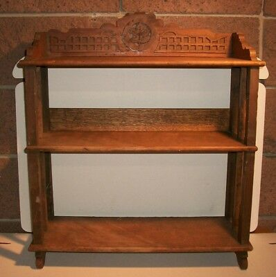 Antique Walnut Small Shelf Unit with Carved Maple Leaf.