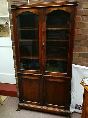 Antique dresser/cabinet with glass doors and original working key