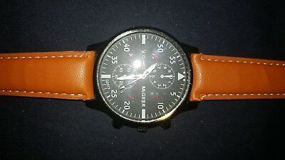 Lot of 4 Men's bargain watches, 3 leather bands, and a metal bracelet
