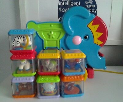 Fisher Price Musical Rolling Elephant Circus Peek A Blocks Poppity Pop Pull Toy