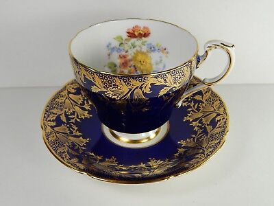 Paragon Tea Cup and Saucer. Blue with Gold Floral Pattern. Violet Blue.
