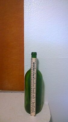 1 empty green magnum wine bottle large  2 used corks per bottle 12 x 3.5 x 12