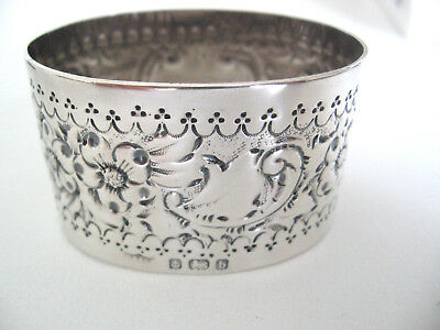 Very ornate English Sterling silver napkin ring heavily decorated, 117 years old
