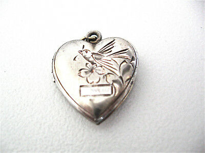 Ornate Antique Sterling silver heart shaped pendant decorated with a bird