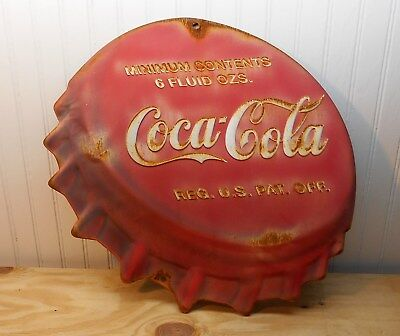 COCA COLA metal sign RUSTY, DENTED and faded, bottle cap shaped embossed